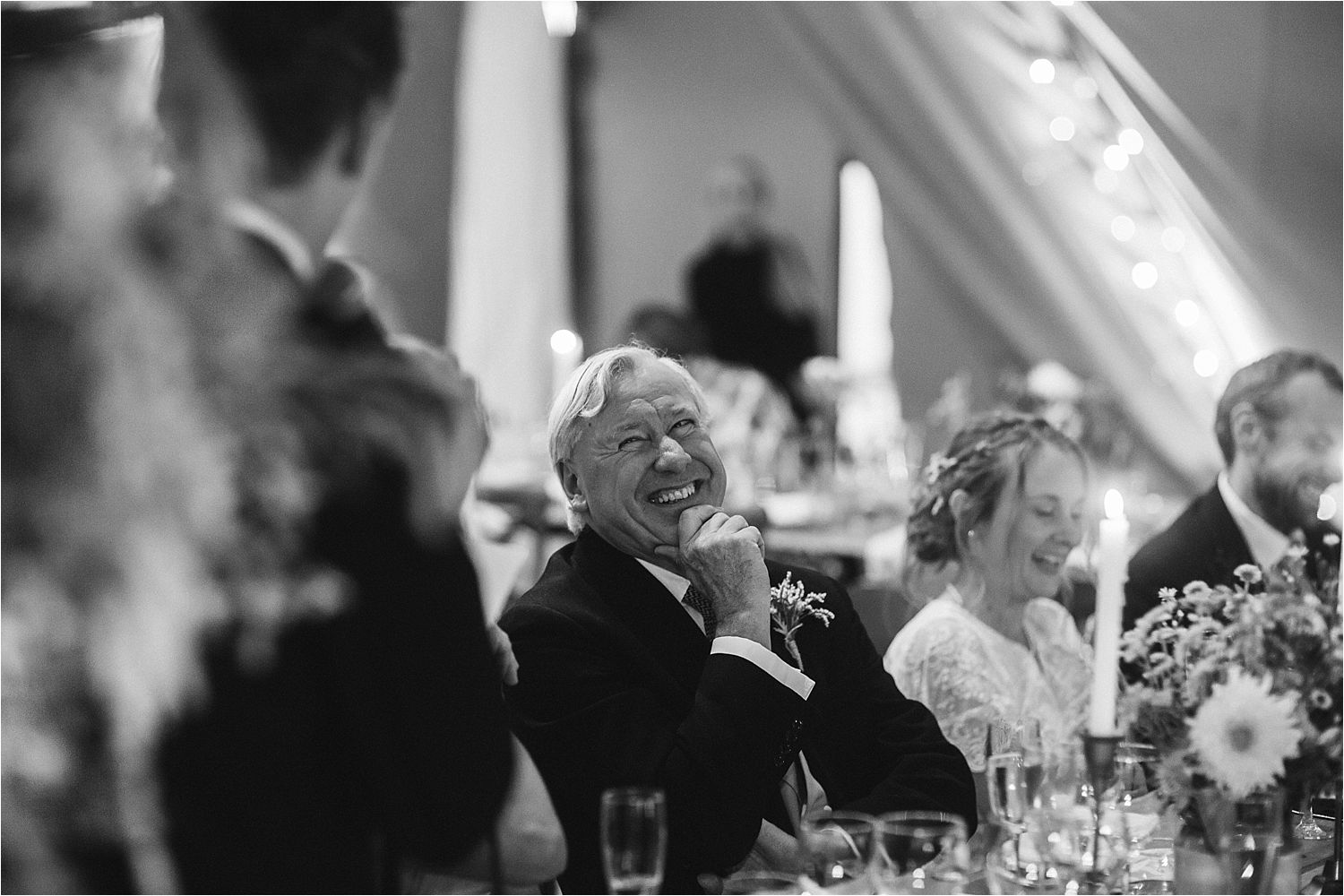 Guests enjoying the speeches at Manchester tipi wedding reception
