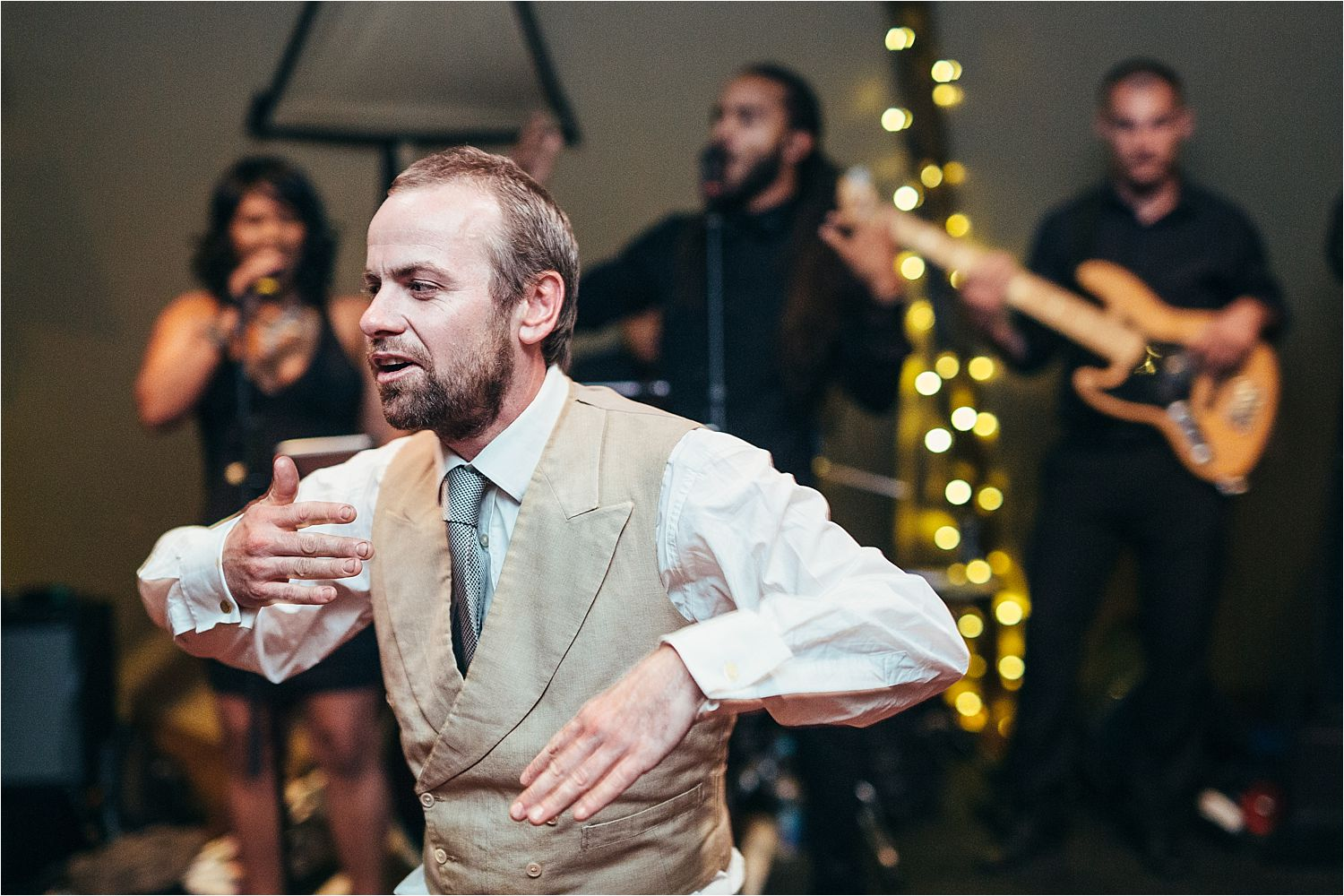 Bridegroom dancing at evening party for rural Mancheter wedding