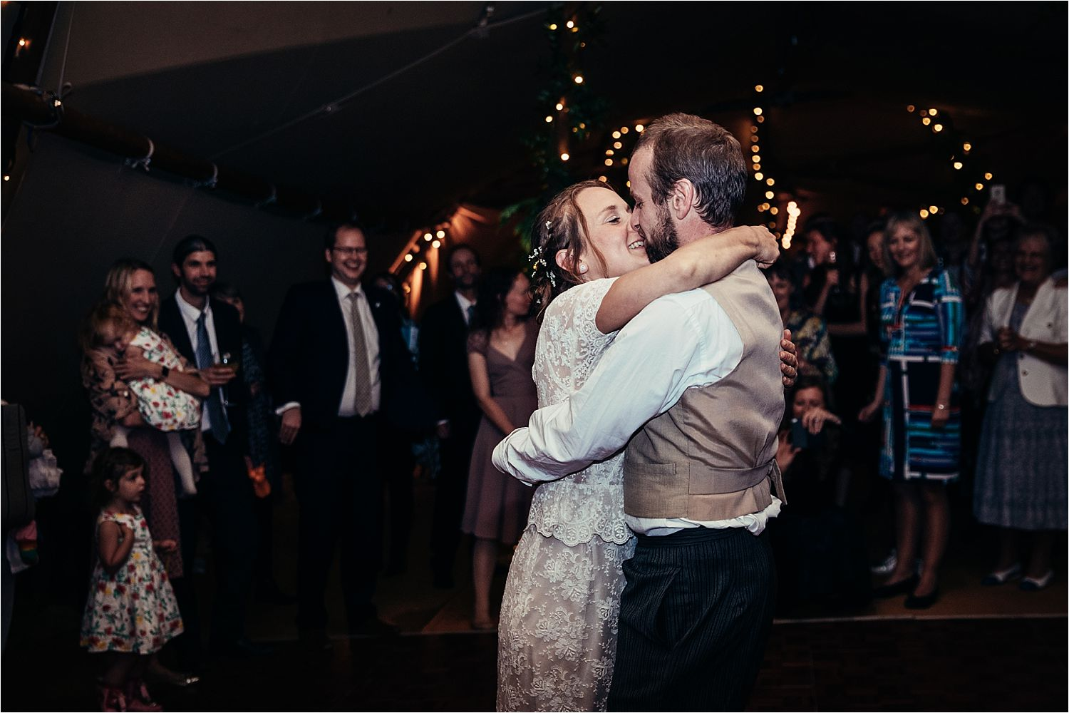 Guests watching the first dance at North West Tipi wedding reception