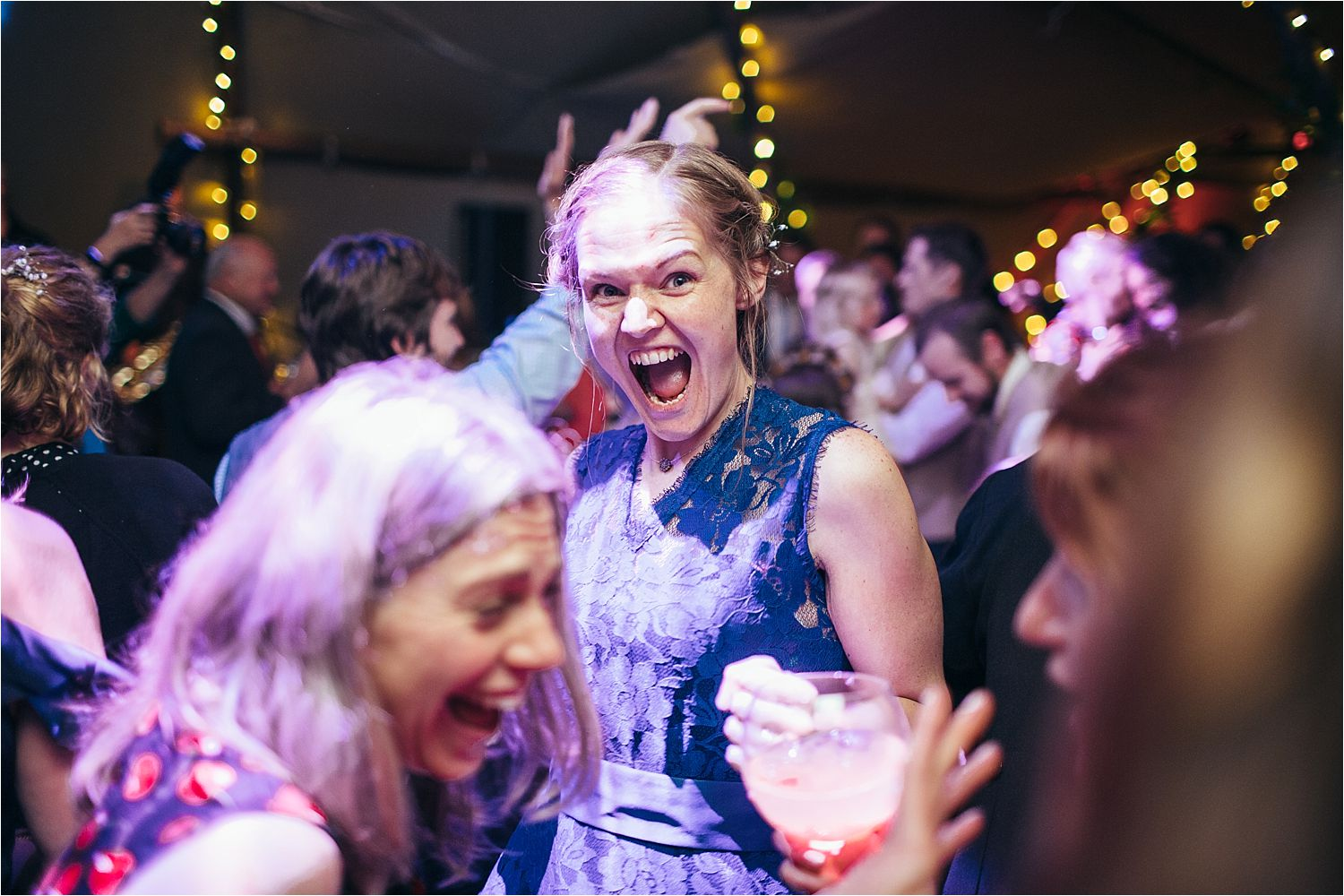 Guests enjoying a party at North West tipi wedding