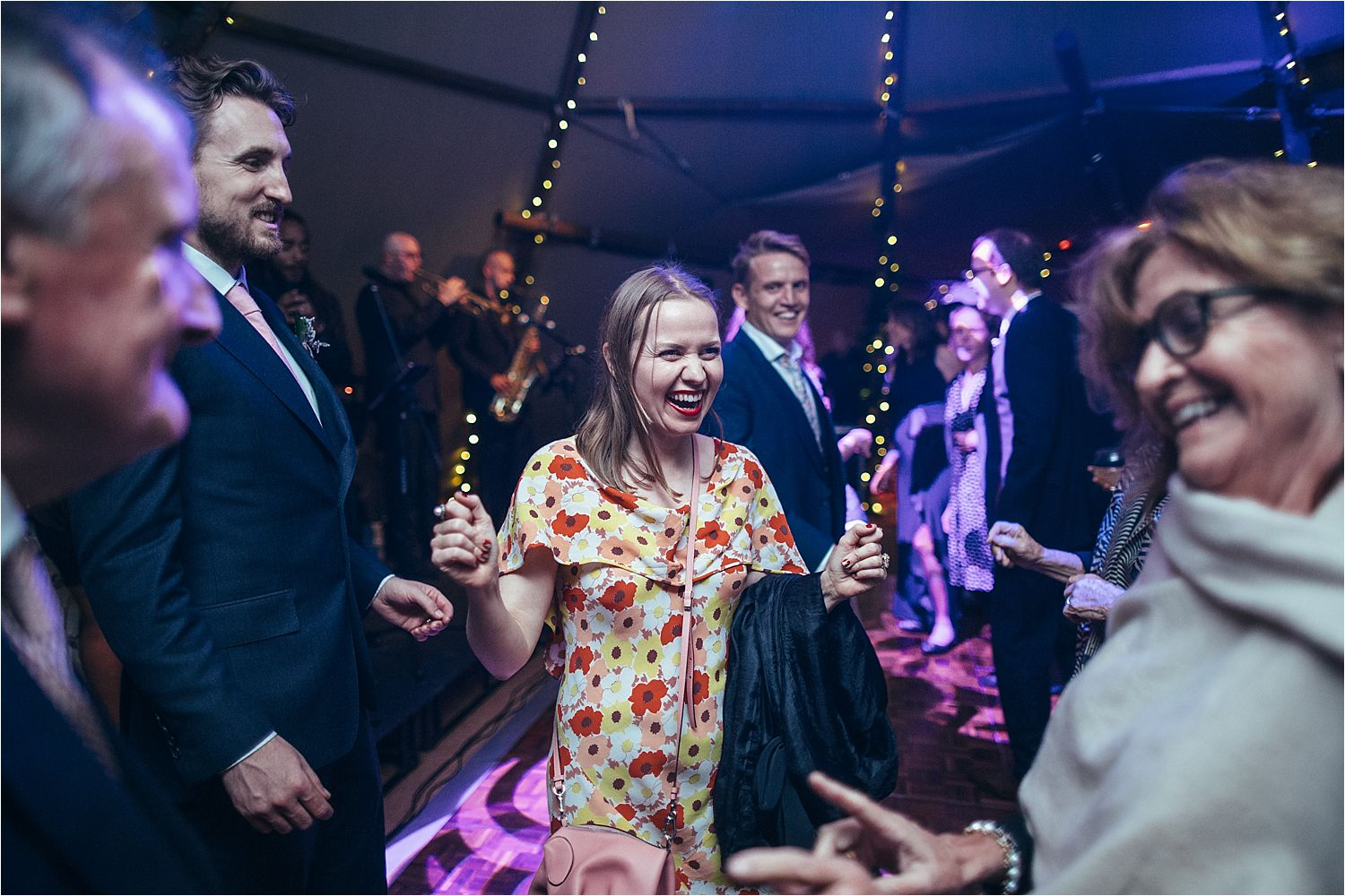 Party people dancing at North West tipi wedding