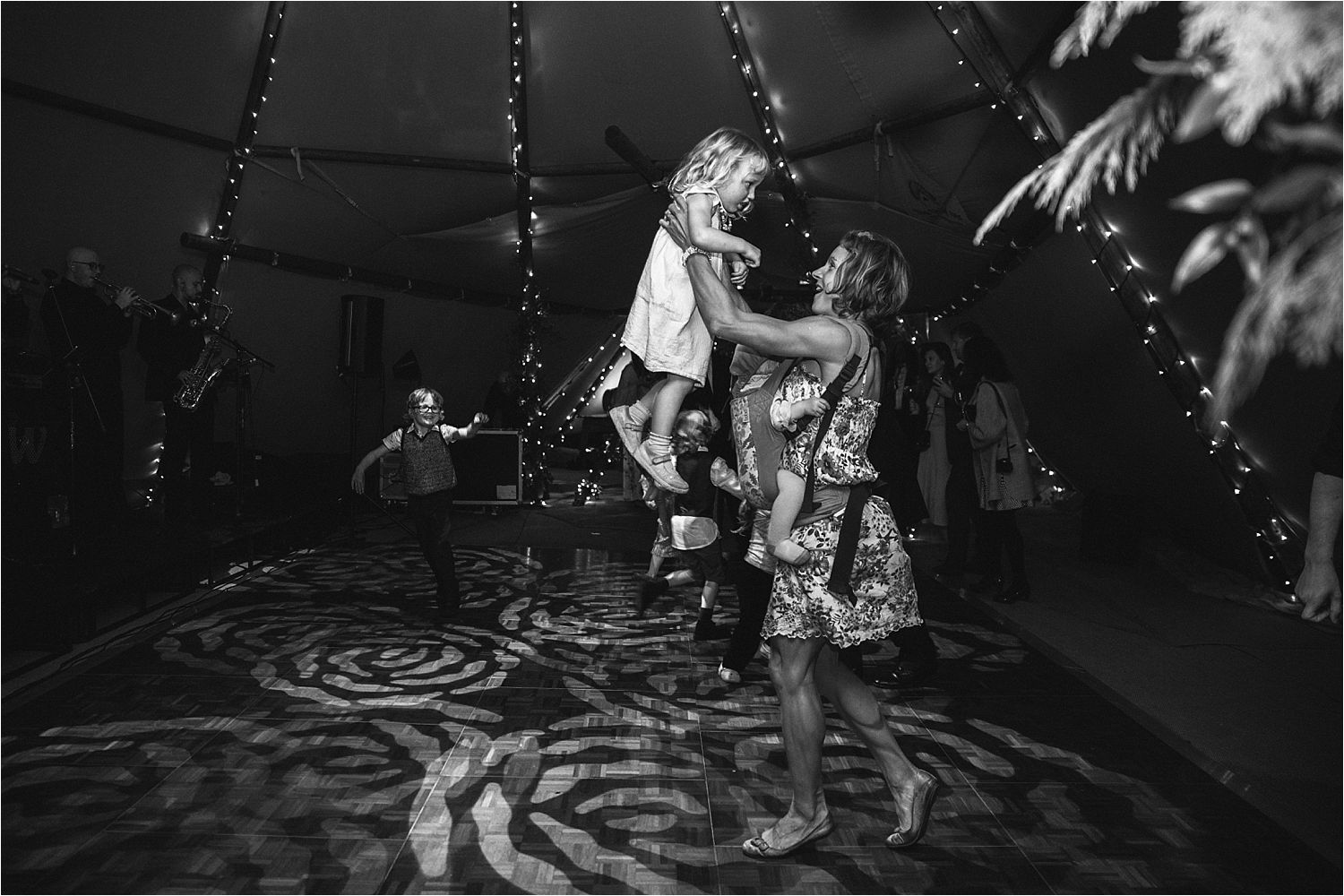 Mum dancing with her daughter and new baby at tipi wedding reception. Tipi by Big Chief Tipis, Manchester