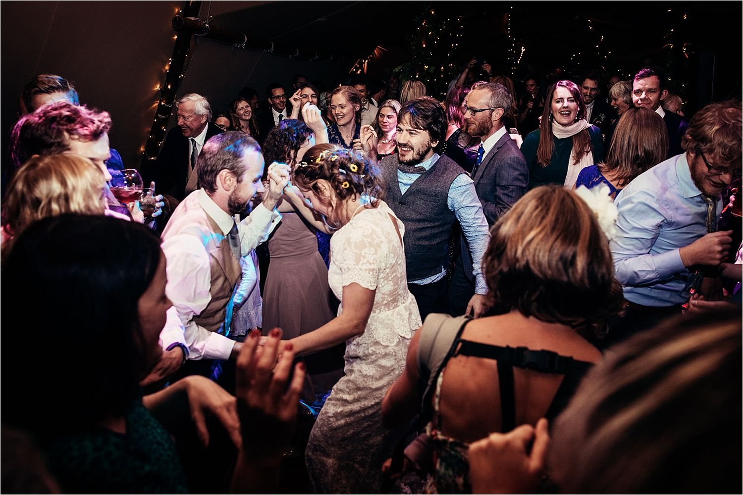 Busy dancefloor at North West tipi wedding, Manchester