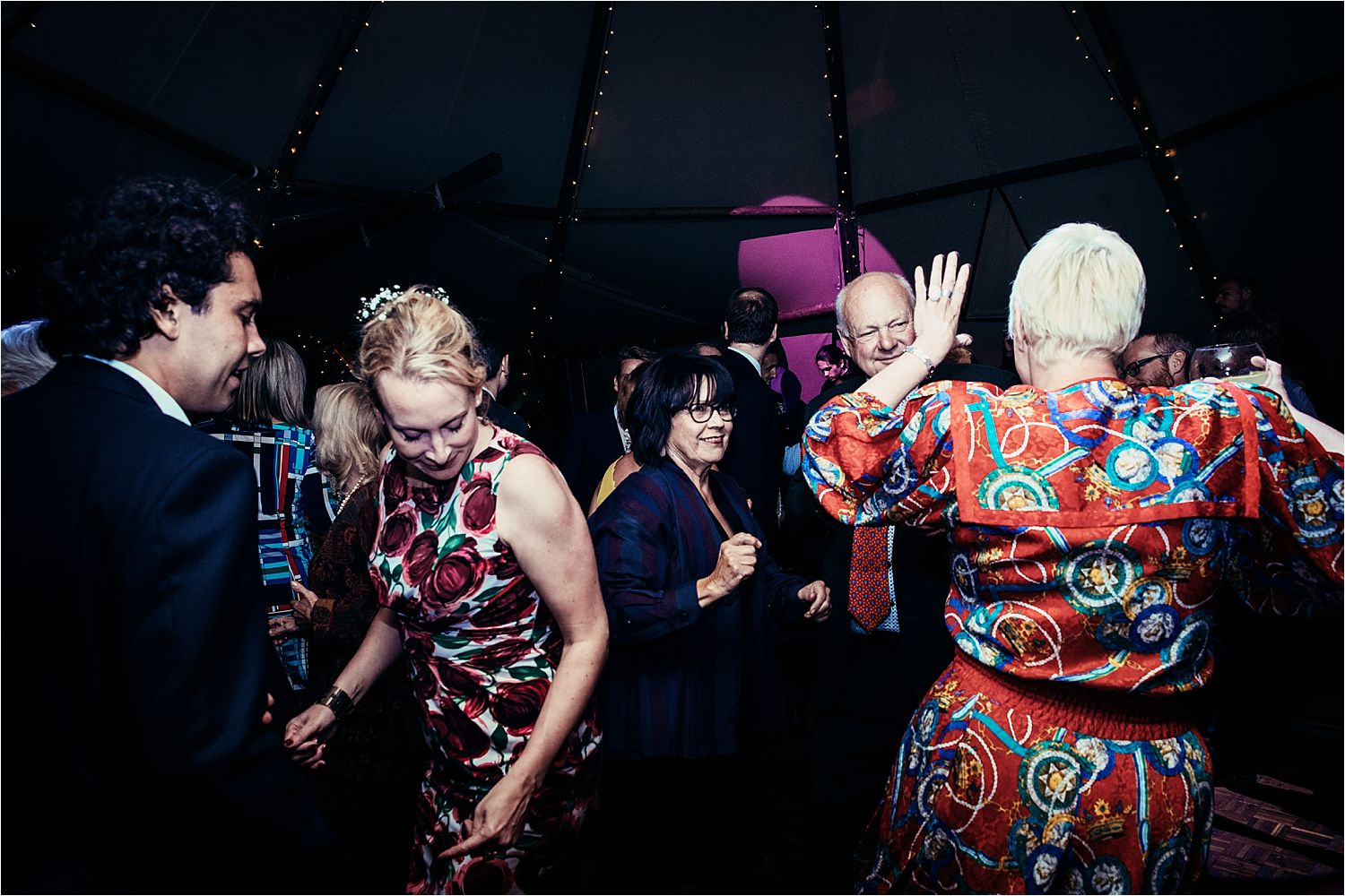 Dancing guests at Manchester tipi wedding