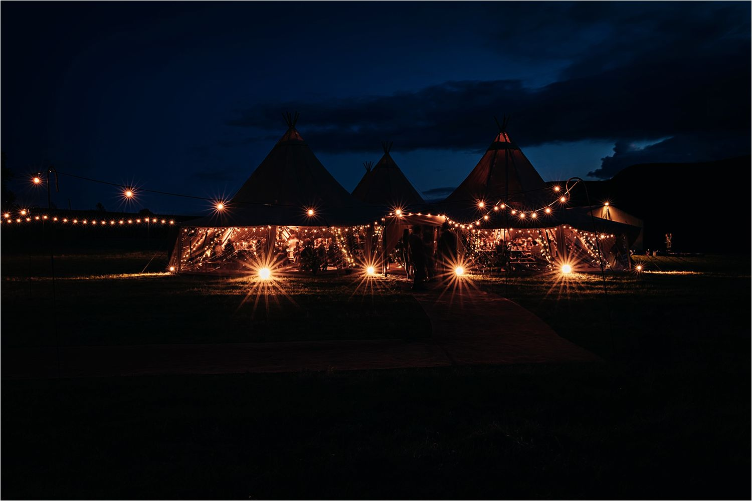 Night time exterior shot of Big Chief Tipis tipi all lit up in Manchester moorland setting