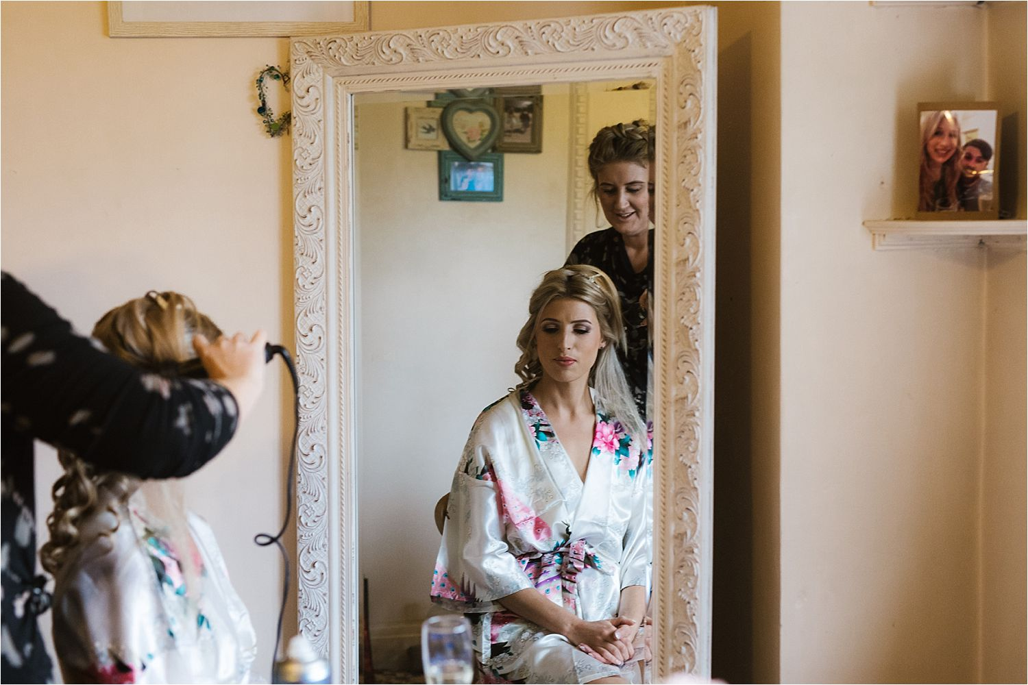 Bride having her hair done for her Belmount Hall wedding