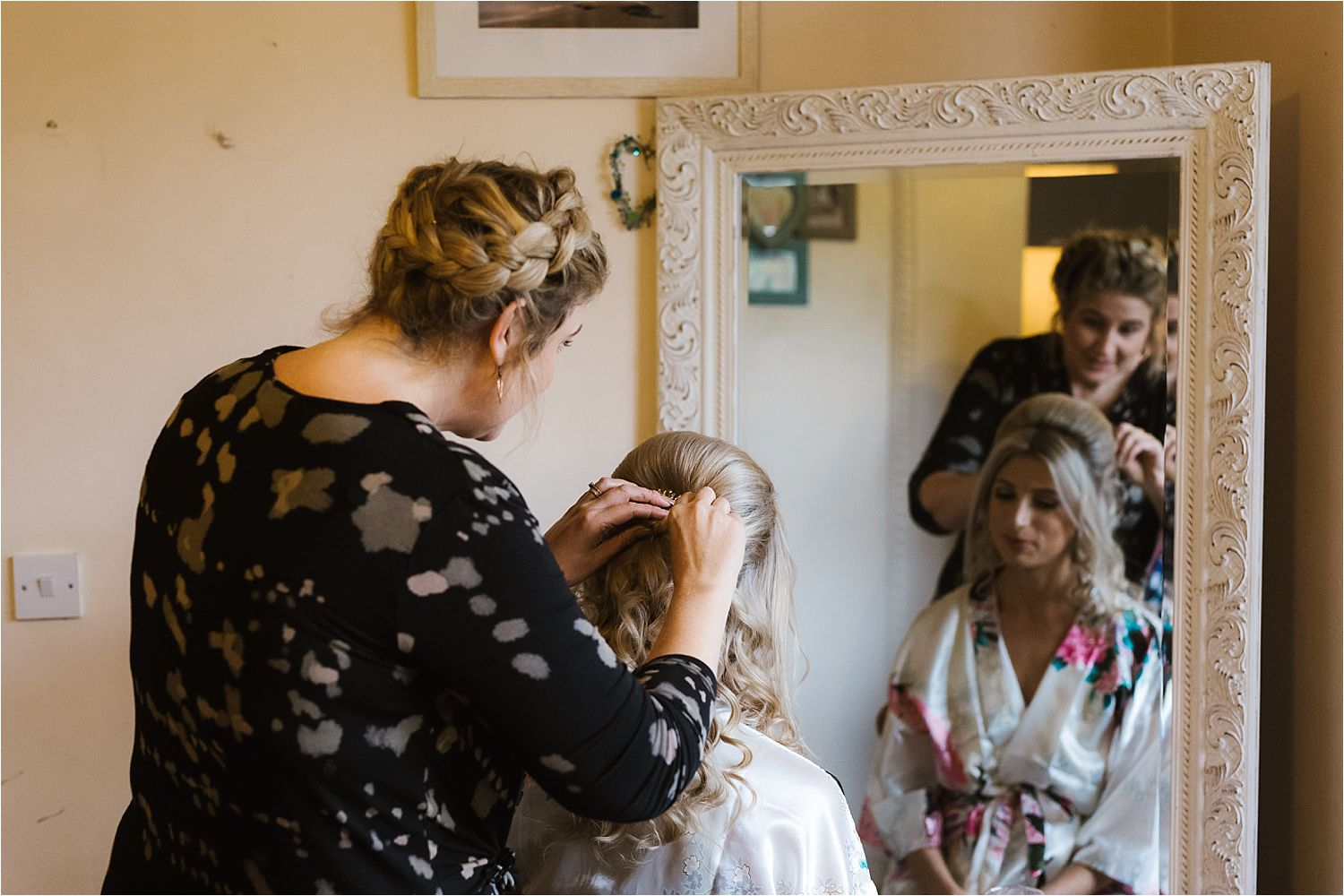 Finishing touches to bride's hair prior to her Lake District wedding at Belmount Hall