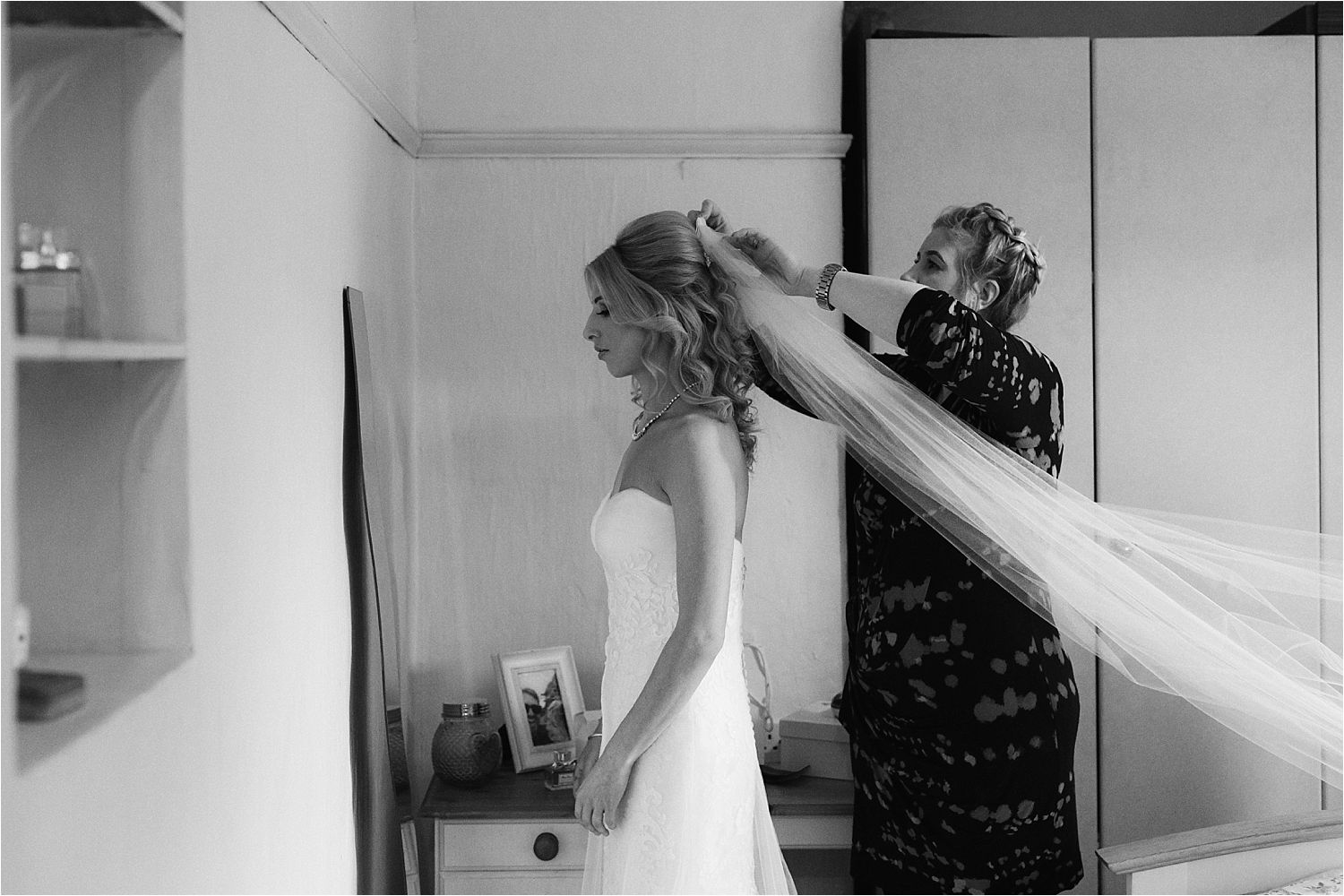Bride's veil being pinned in as she gets ready for her Belmount Hall wedding