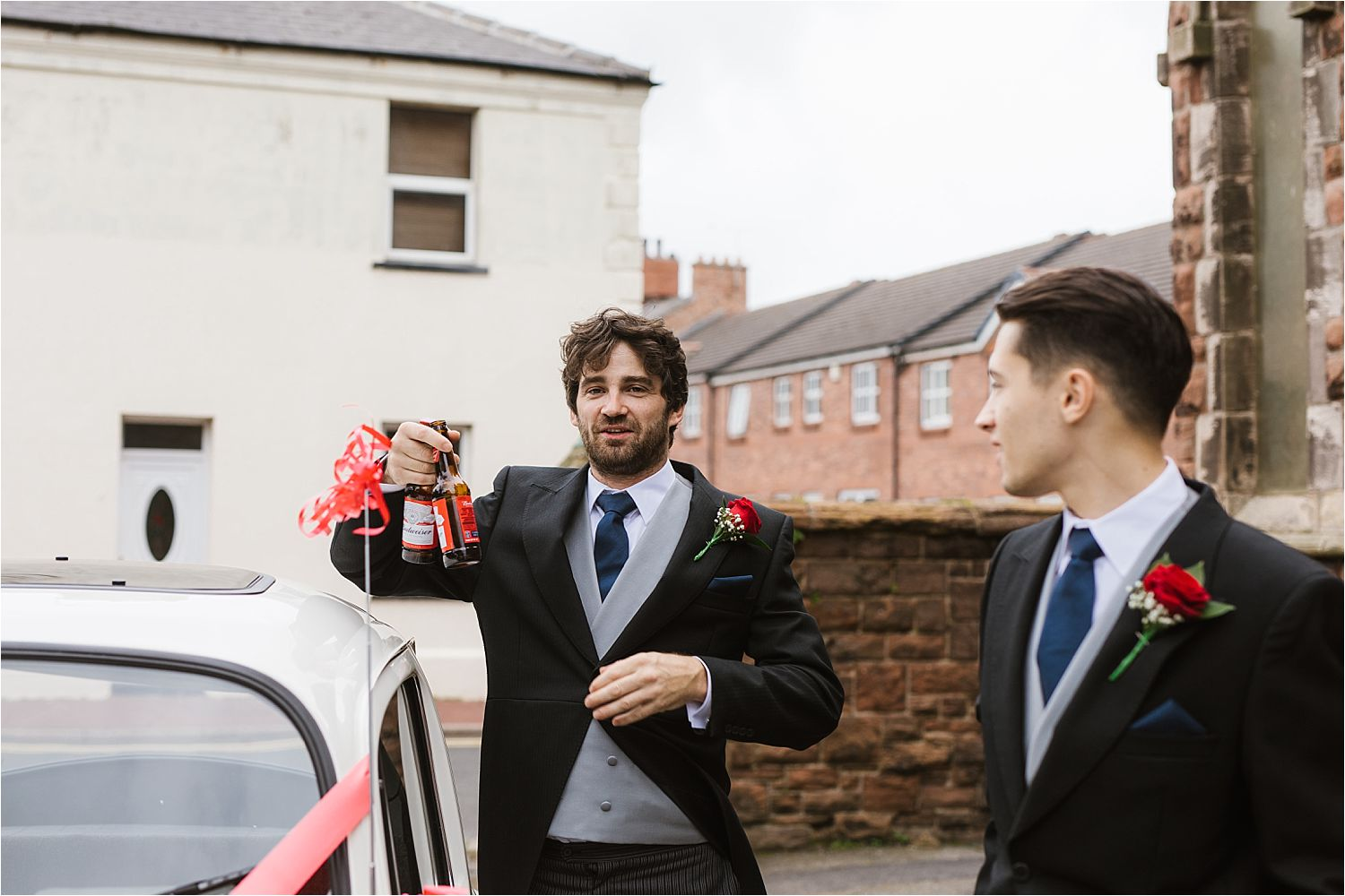 Best man and usher with 2 bottles of Budweiser prior to Lake District wedding