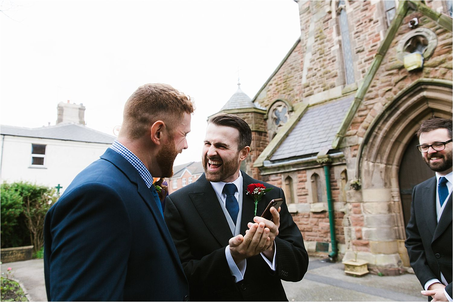 Bridegroom and ushers share a joke outside Cumbrian church