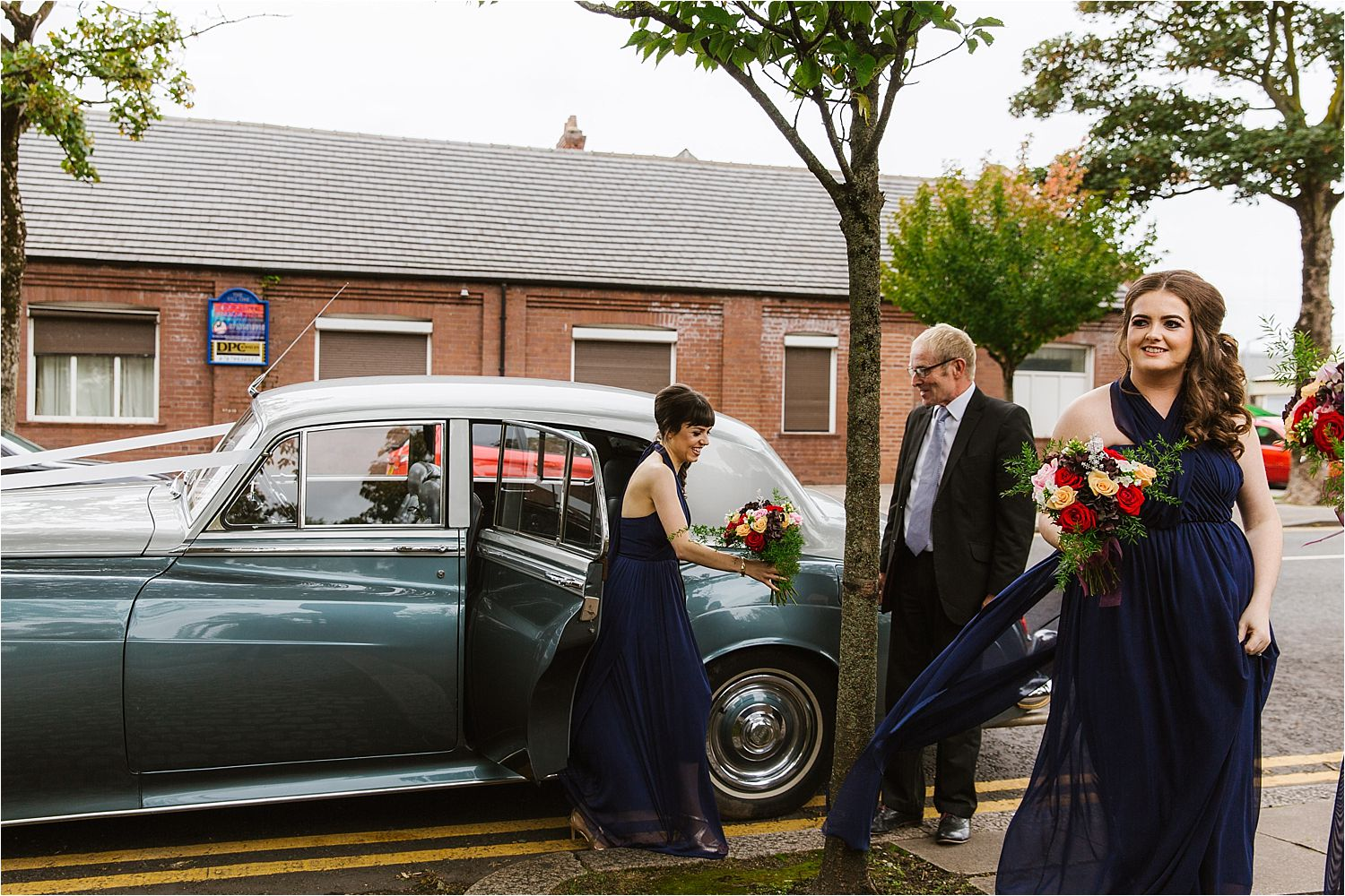 Bridesmaids arriving for Cumbrian wedding ceremony