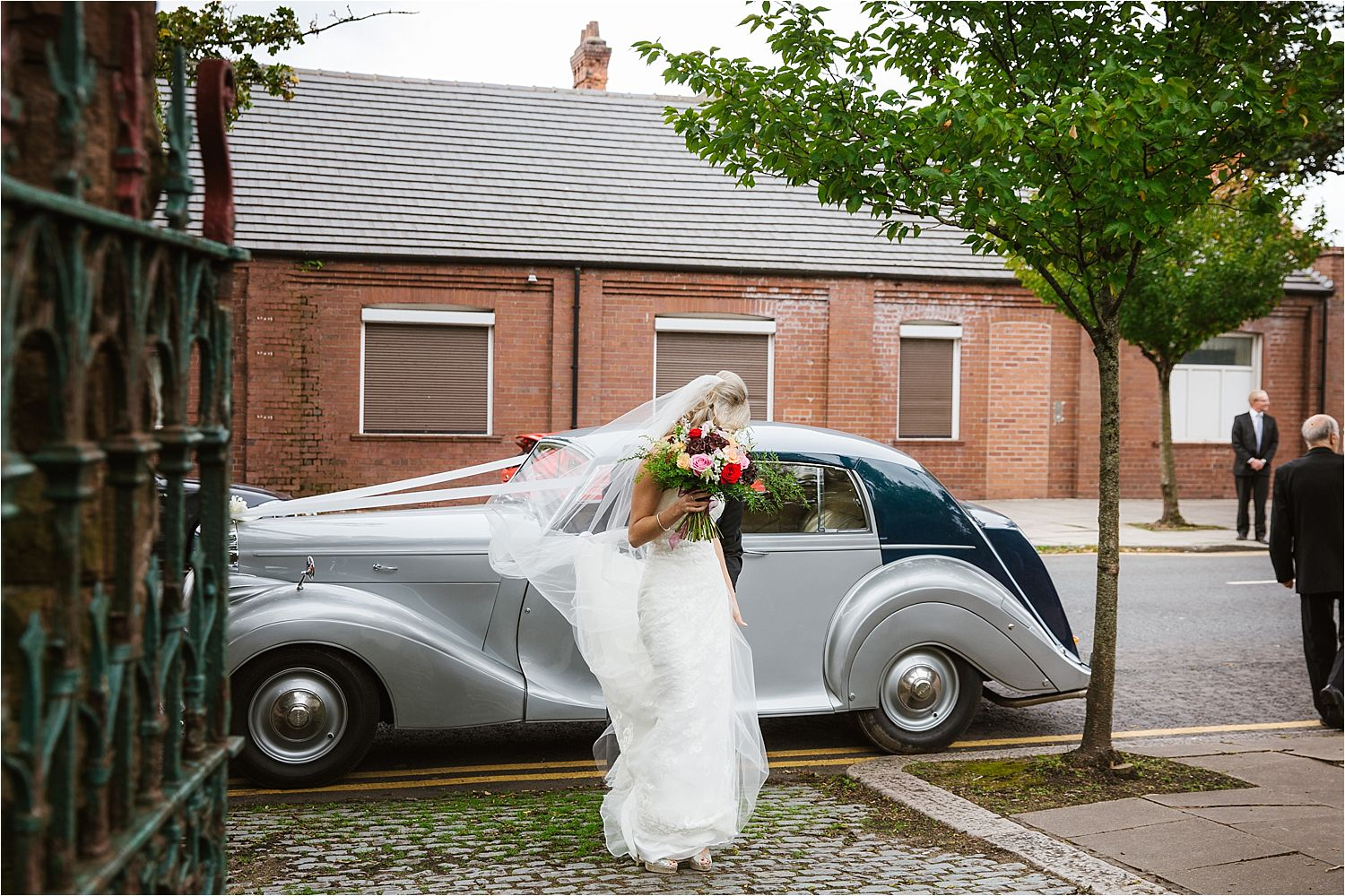 Bride arrives in wedding car by John Wilson from Walney, flowers by Deborah's florist, Barrow