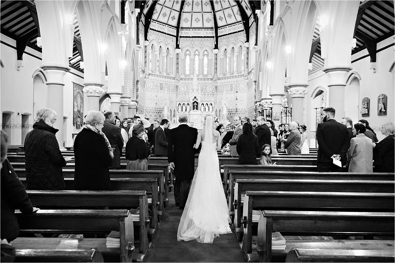 The bride and her father walk down the aisle in Cumbrian church.