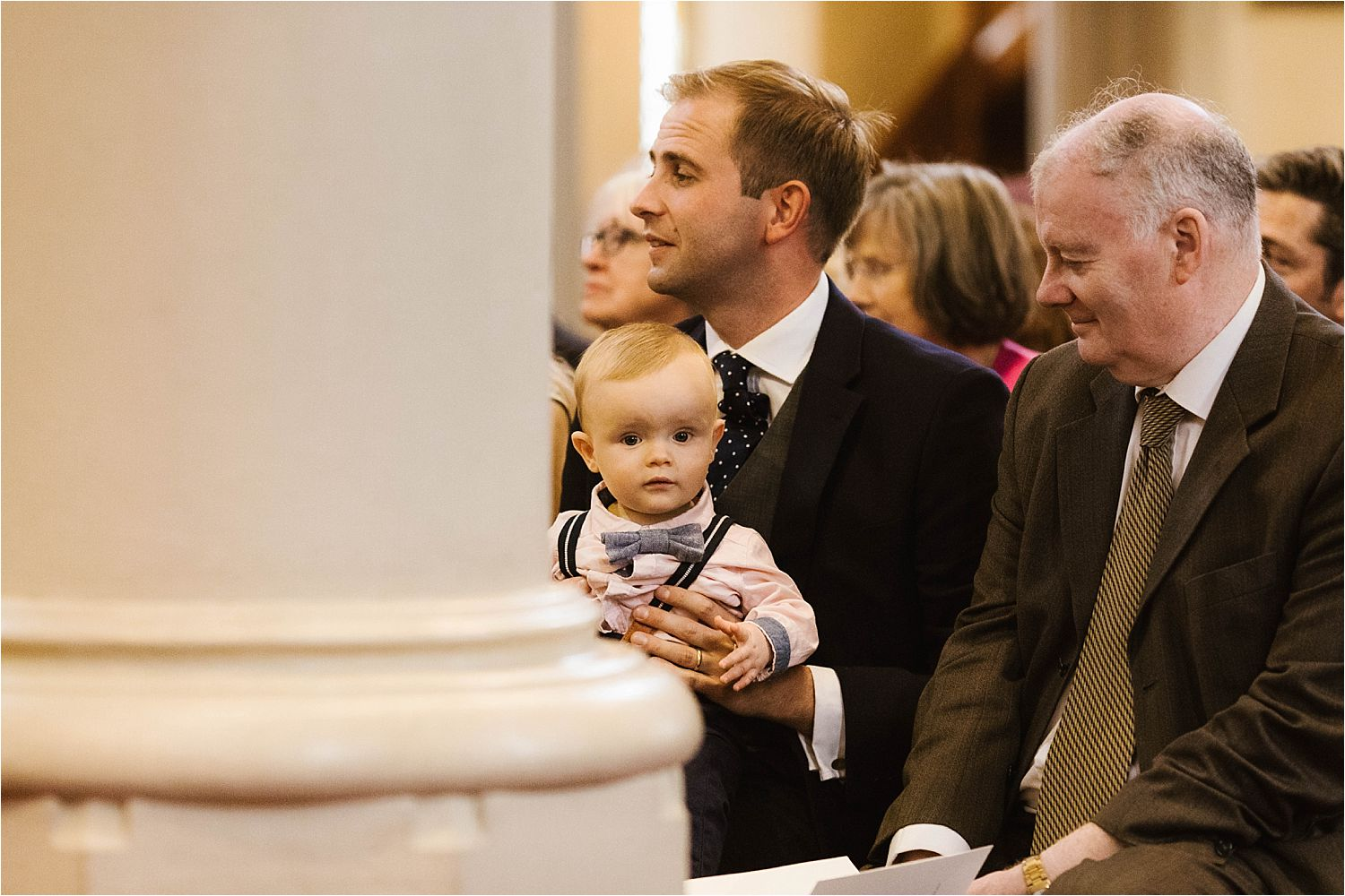 Baby in congregation at west Cumbrian wedding