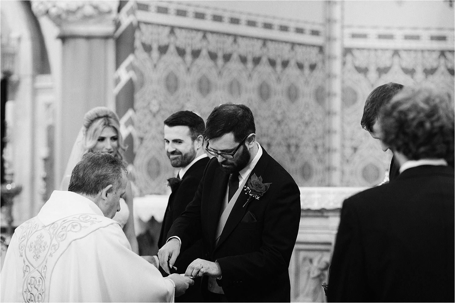 Best man gives the rings to the vicar at Cumbrian wedding