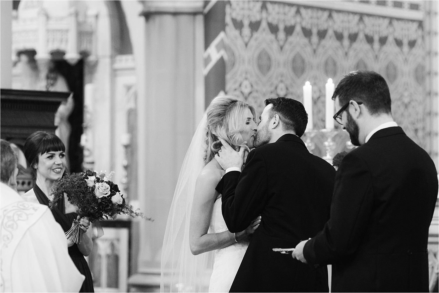 Bride and groom exchange a kiss during wedding ceremony