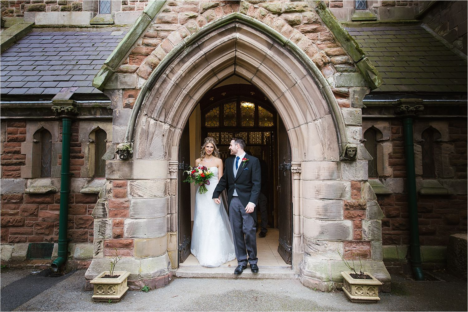 The wedding couple at the church door after their Cumbrian wedding