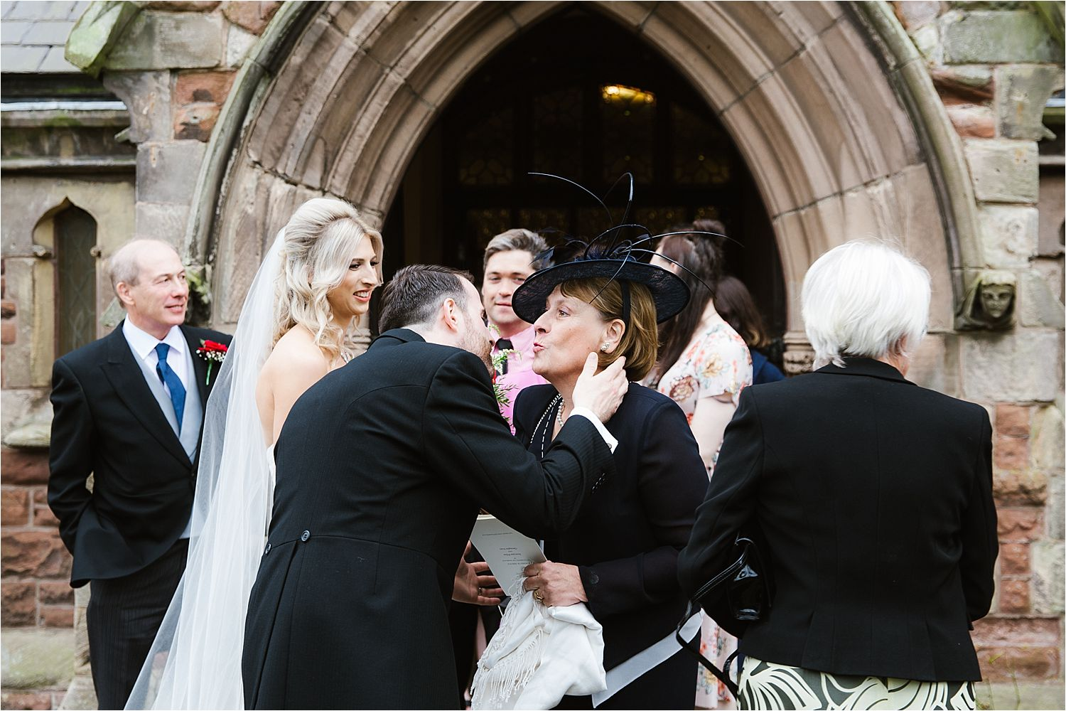 Bride groom kisses guest after his wedding in West Cumbria