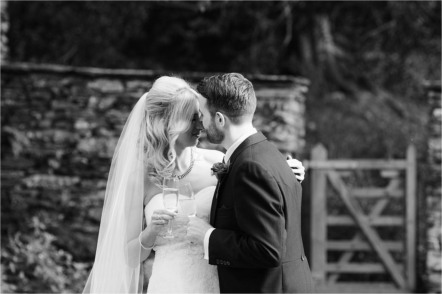 A close hug in the grounds of Belmount Hall for the bride and groom