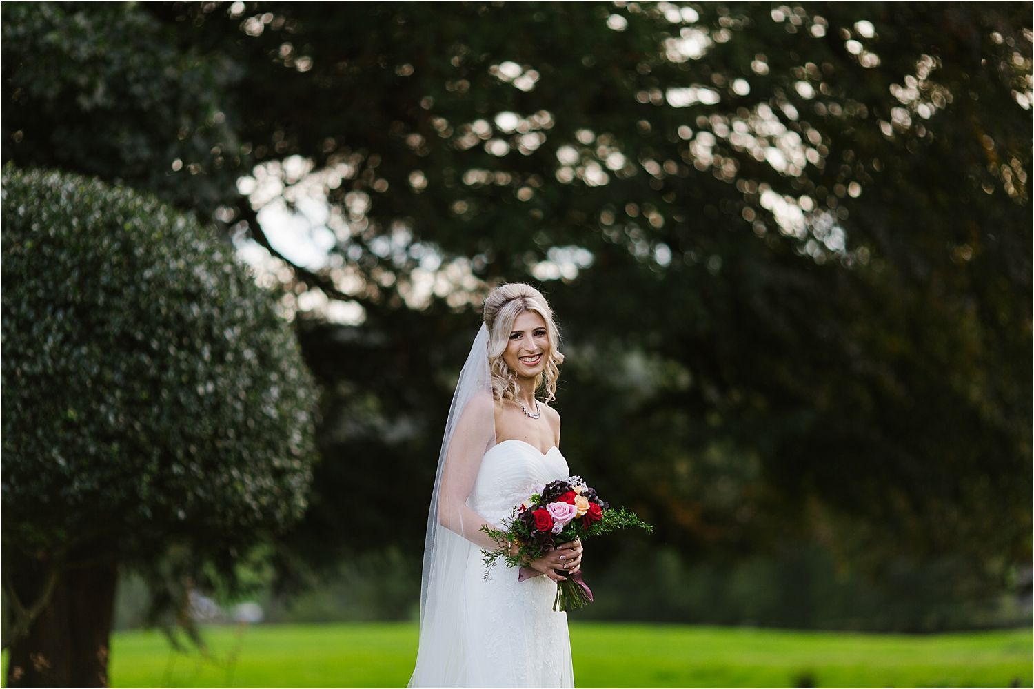 Bride in gardens of Belmount Hall. Bouquet by Deborah's Flowers of Barrow