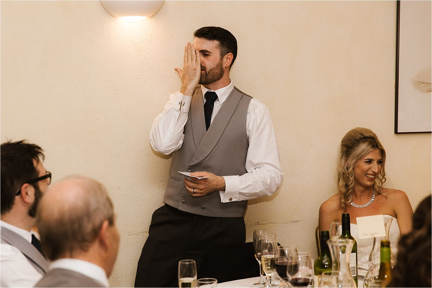 Bride enjoys groom's speech at Lake District wedding reception
