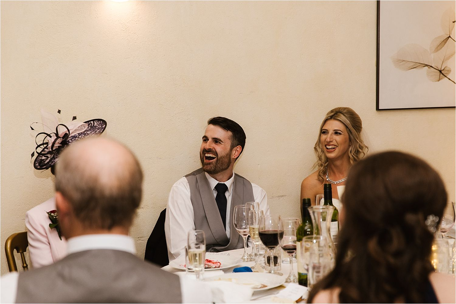 Bride and groom's reactions to best man's speech at their Lake District wedding