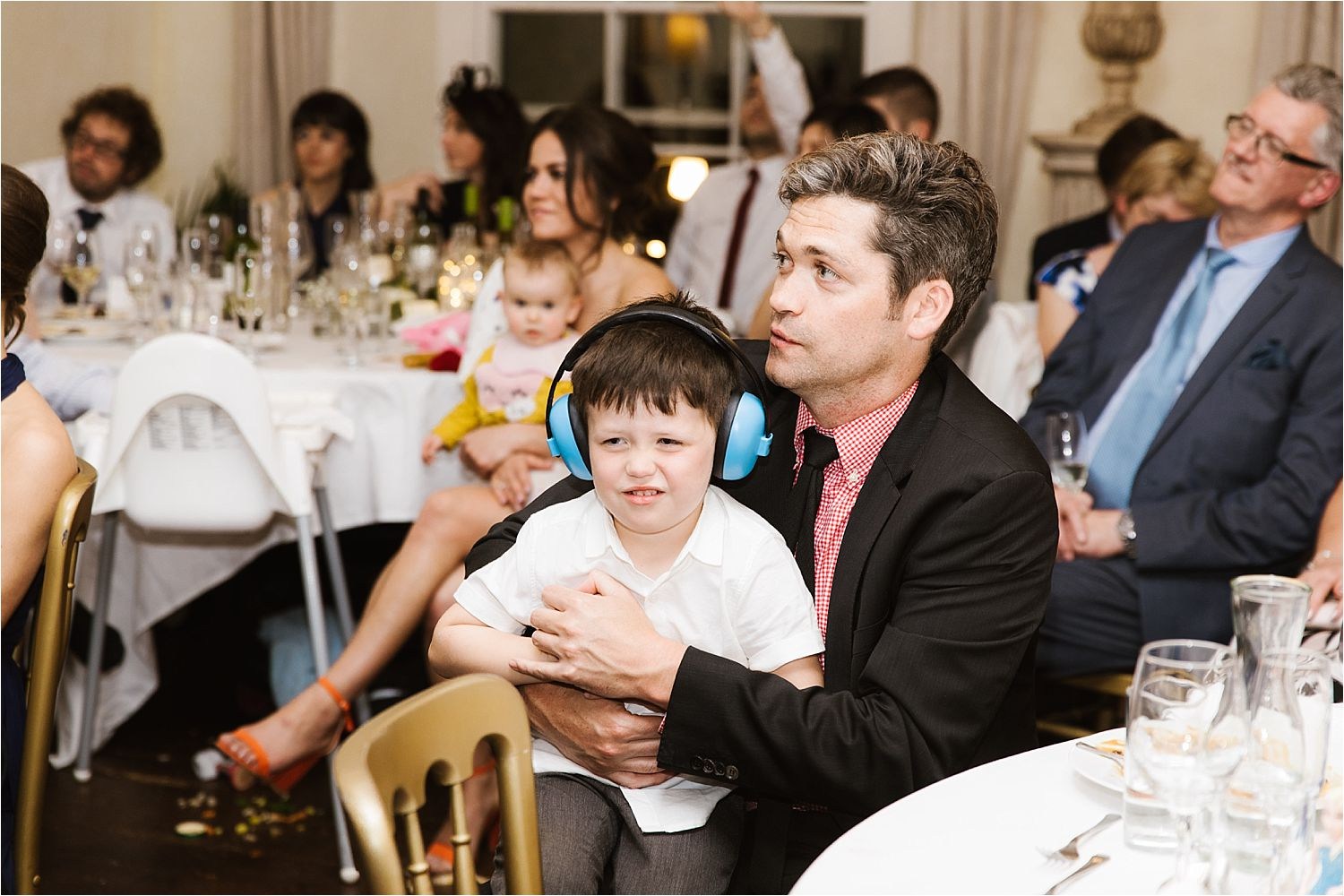 Little boy in headphones at Lake District wedding reception