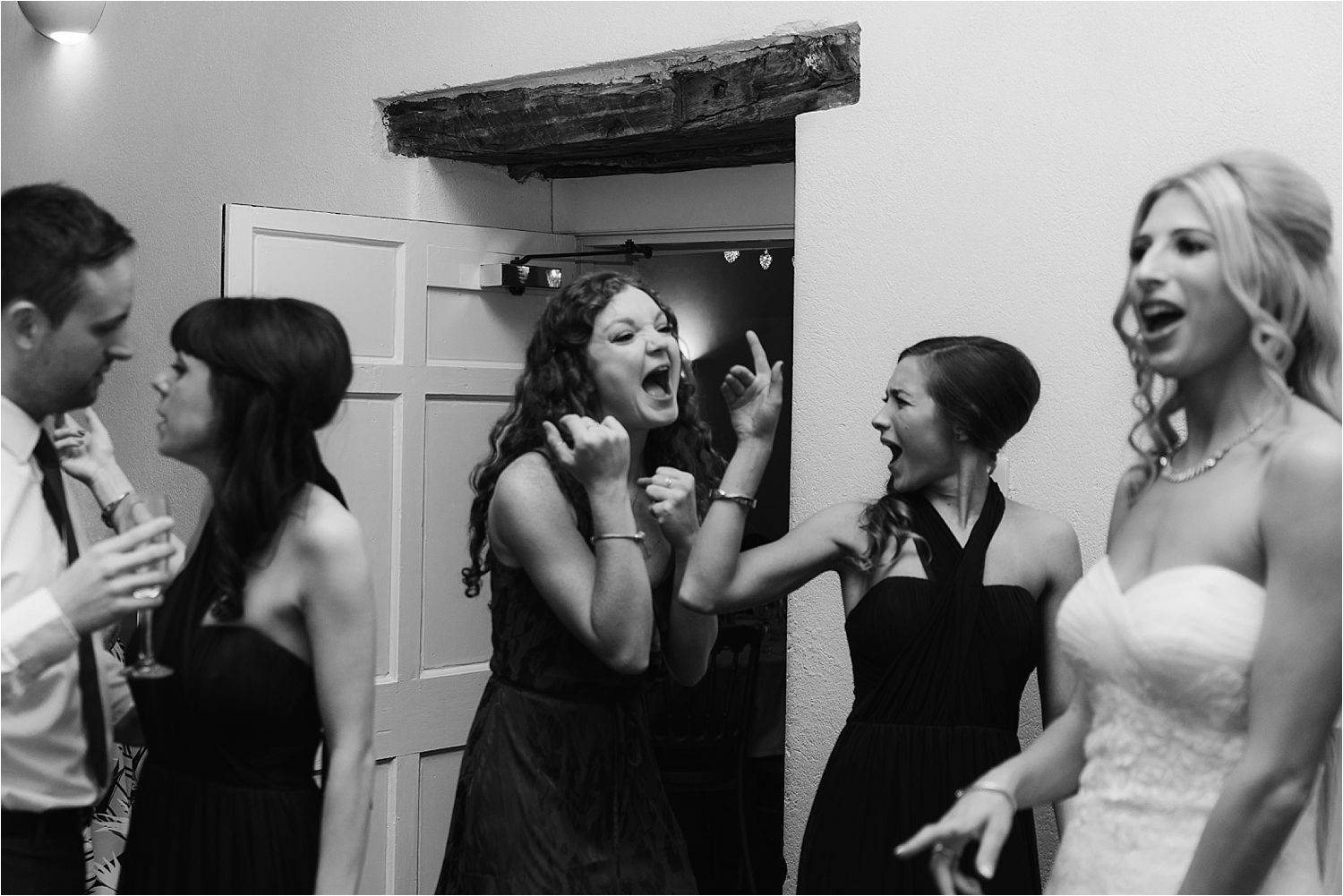 Bride and bridesmaids enjoying a dance at Lake District wedding