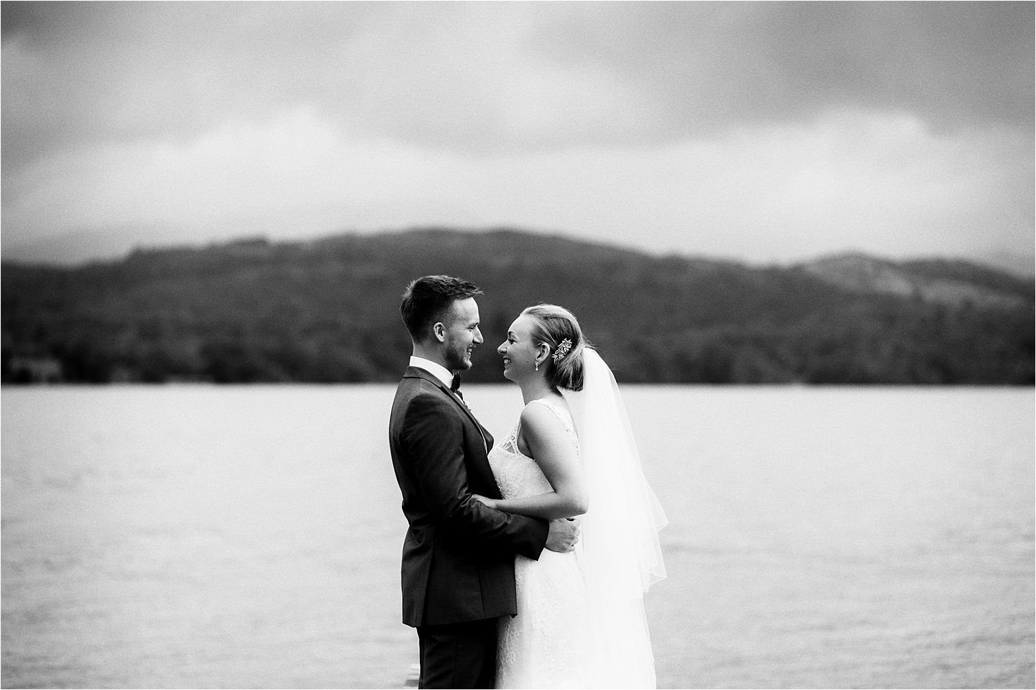 Storm clouds over Lake Windermere for Cumbrian wedding couple
