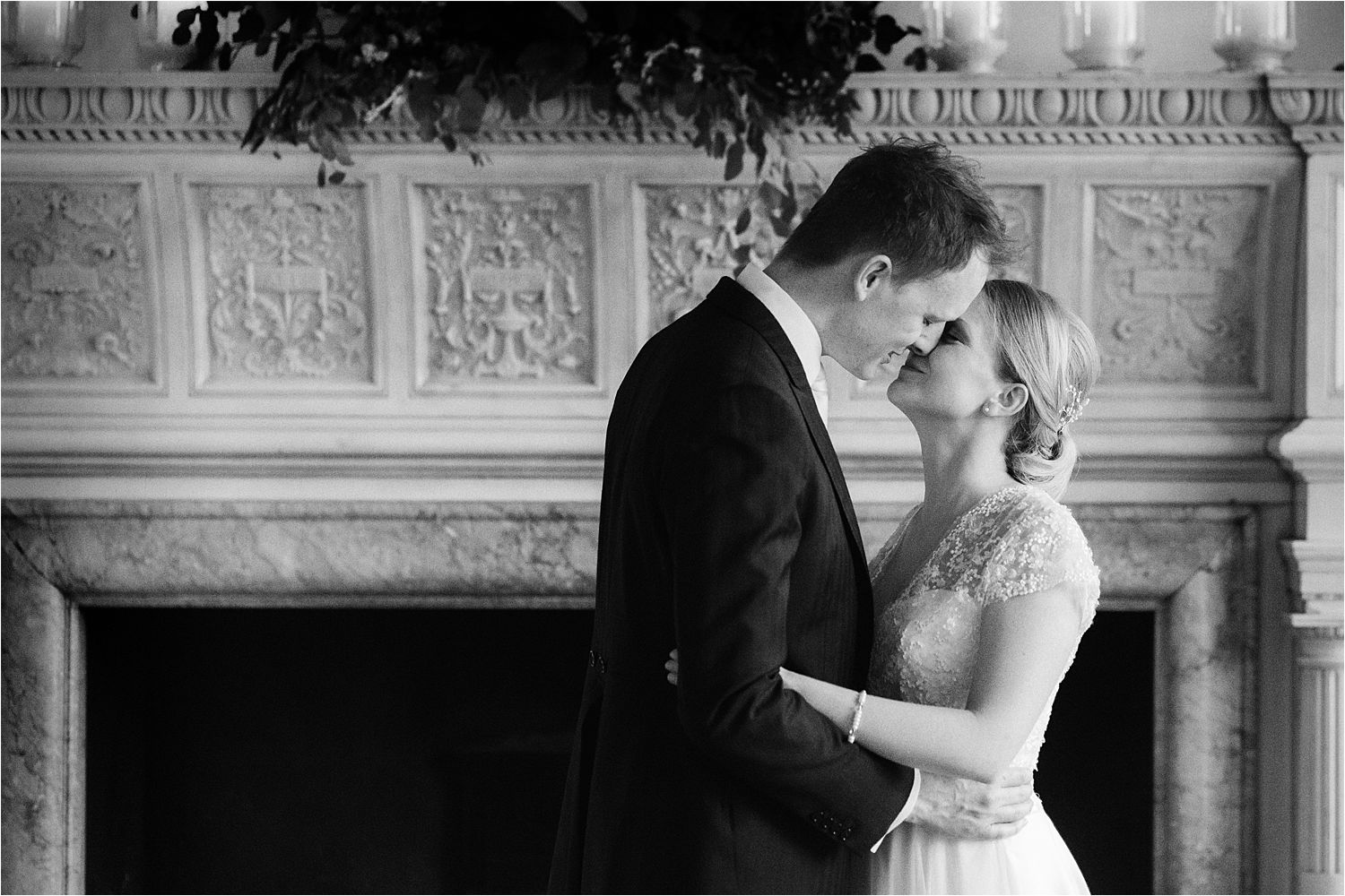 Bride and groom kissing in front of beautiful fireplace on rainy North west wedding day