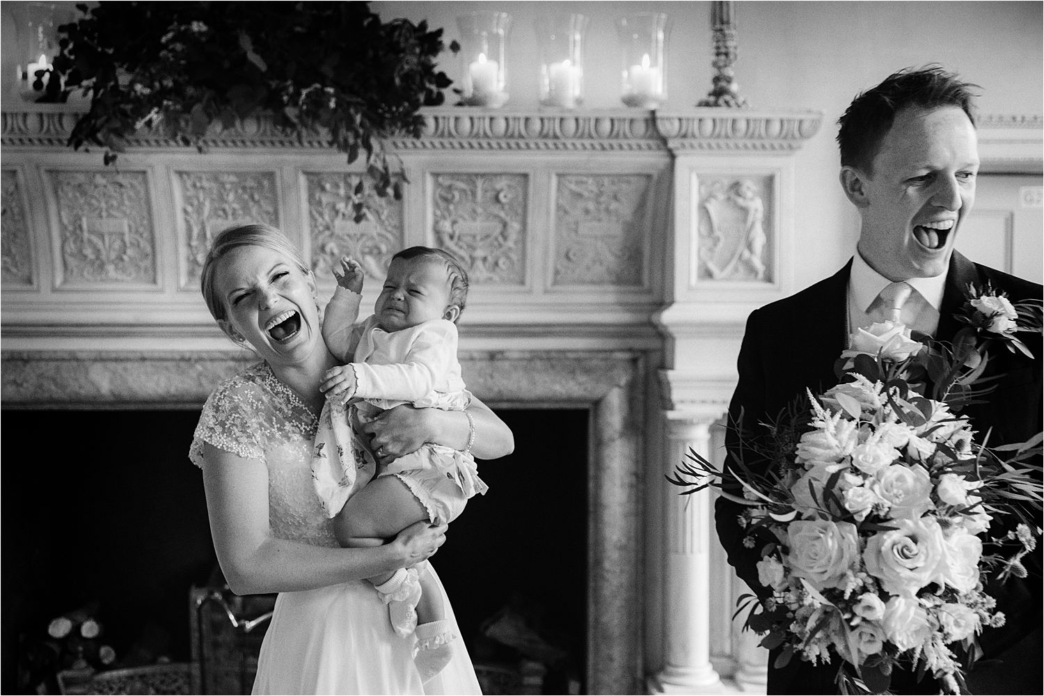 Bride, groom and crying baby in beautiful north west wedding venue